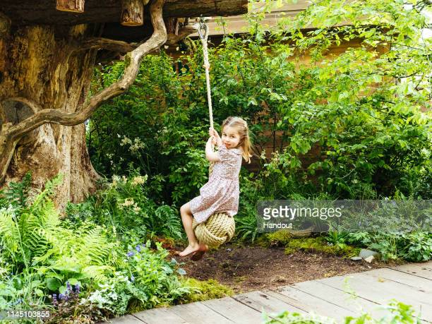 In this undated handout provided by Kensington Palace Princess Charlotte swings from a tree in the Adam White and Andree Davies codesigned garden...