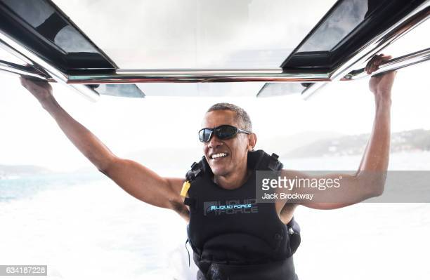 In this undated image former President Barack Obama takes a break from learning to kitesurf at Richard Branson's Necker Island retreat on February 1,...