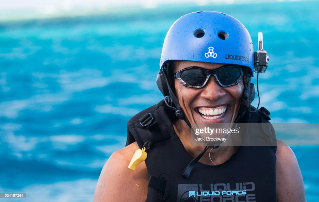 In this undated image Former President Barack Obama takes a break from learning to kitesurf at Richard Branson's Necker Island retreat on February 1, 2017 in the British Virgin Islands. Former President Obama and his wife Michelle have been on an extended vacation since leaving office on January 20.