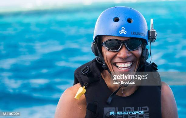 In this undated image Former President Barack Obama takes a break from learning to kitesurf at Richard Branson's Necker Island retreat on February 1...