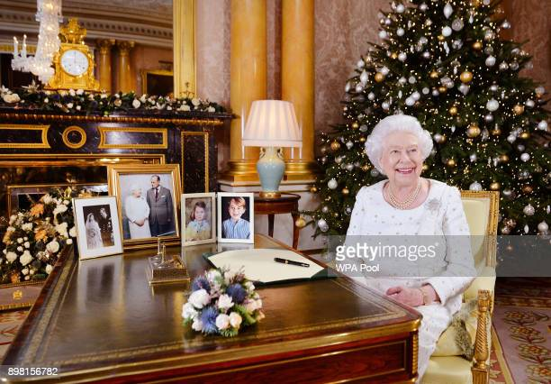 In this undated image supplied by Sky News, Queen Elizabeth II sits at a desk in the 1844 Room at Buckingham Palace, after recording her Christmas...