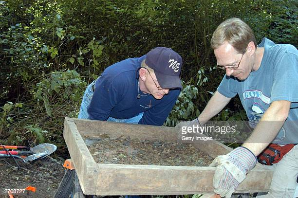 In this undated King County Prosecutor's Office handout photo investigators search for the remains of one of Green River killer Gary Leon Ridgway...