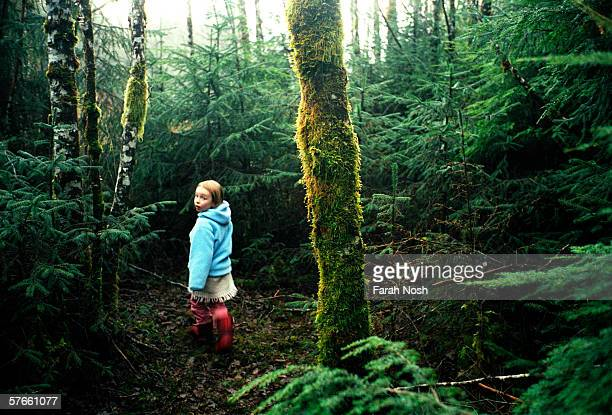 In this undated photo a young girl walks through the forest in the northern end of the Queen Charlotte Islands the Canadian archipelago south of...