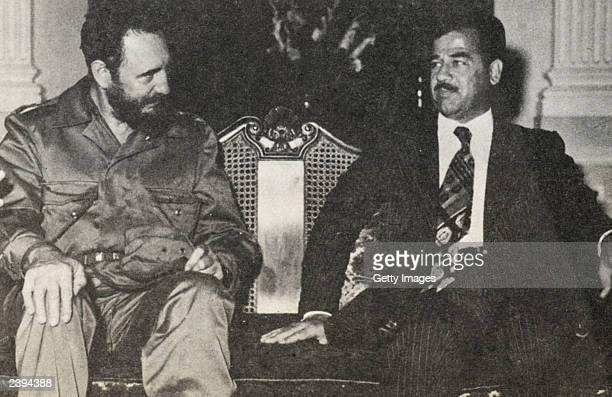 In this undated photo Saddam Hussein poses with Fidel Castro Castro who turns 77 August 13 has been in power for 44 years making him the world's...