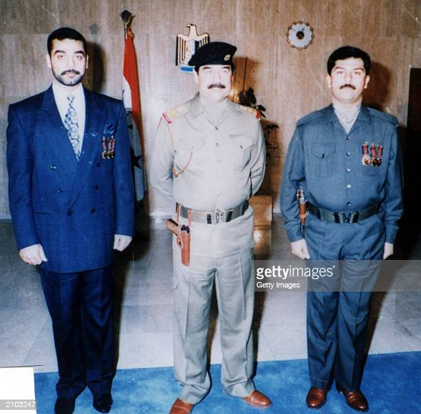 In this undated photo Saddam Hussein poses with his sons Uday and Qusay Officials say the United States is offering a $25 million reward for any...