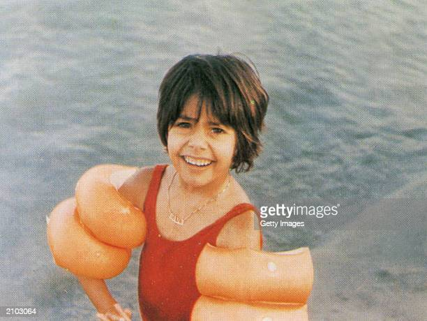 In this undated photo Saddam Hussein's daughter Hala is seen in a swimming pool