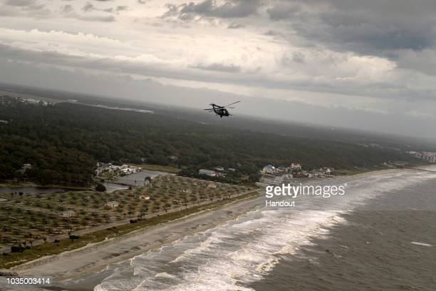 In this U.S. Air Force handout, an HH-60G Pave Hawk assigned to the 334th Air Expeditionary Group flies over the South Carolina coastline, Sept. 16,...