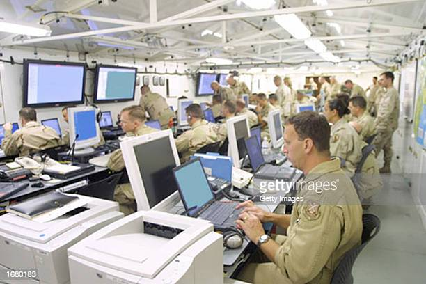 """In this U.S. Army handout, soldiers are seen monitoring computer screens inside the U.S. Central Command's """"Deployable Headquarters,"""" this image was..."""