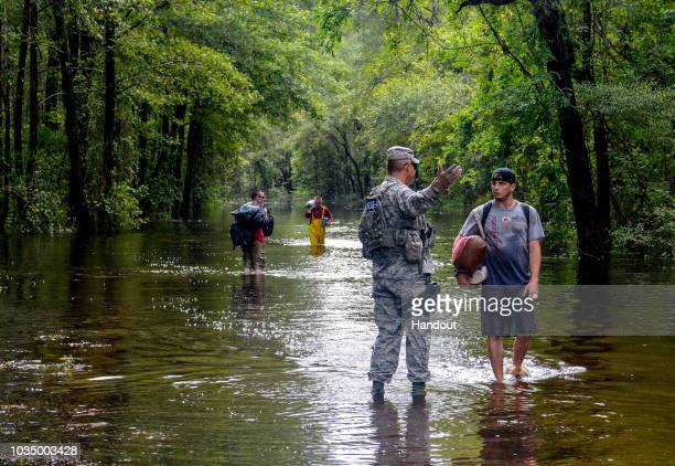 In this US Army National Guard handout a US Air Force Security Forces Airmen assigned to the South Carolina Air National Guard 169th Fighter Wing...