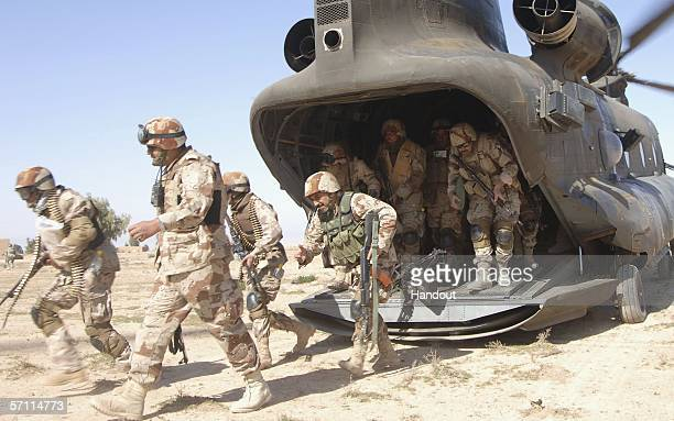 In this U.S. Military handout, Iraqi Army Soldiers from 4th Iraqi Army Division leave a CH-47 Chinook helicopter during of Operation Swarmer March 16...