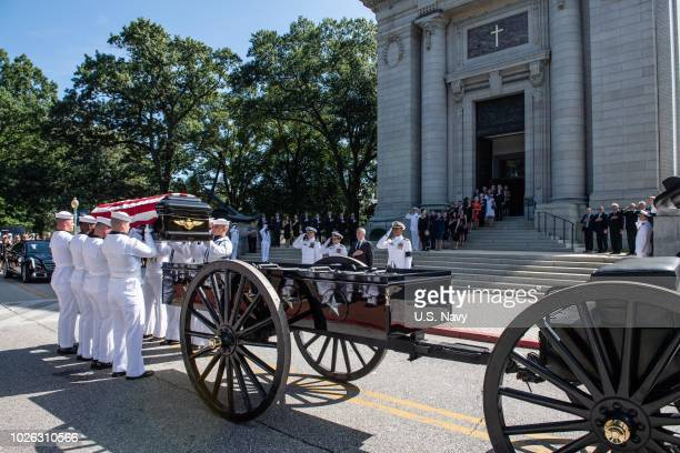 In this US Navy handout Navy Body Bearers place the casket of the late Sen John McCain onto a horsedrawn caisson after his funeral service at the...