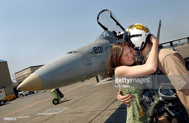 In this US Navy handout photo Lt Jake Parsons hugs his wife upon his return from duty in the Middle East May 1 2003 in Atsugi Japan Lt Parsons is...