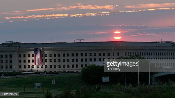 In this US Navy handout sunrise at the Pentagon prior to a ceremony to commemorate the 15th anniversary of the Sept 11 2001 terror attacks The...