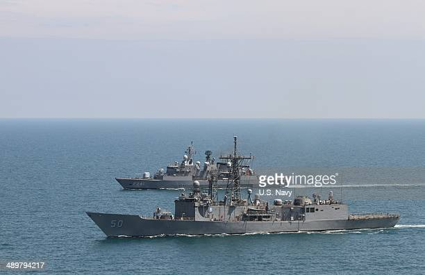 In this US Navy handout The guidedmissile frigate USS Taylor and the Turkish frigate TCG Turgutries conduct a tactical maneuvering exercise May 11...