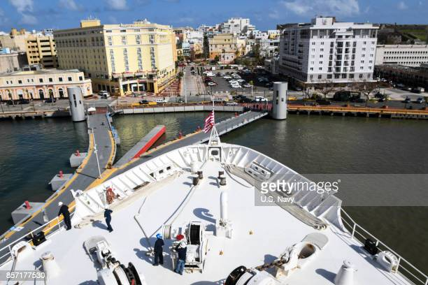 In this US Navy handout the Military Sealift Command hospital ship USNS Comfort arrives for humanitarian operations on October 3 2017 in San Juan...