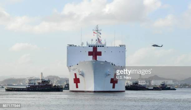 In this US Navy handout the Military Sealift Command hospital ship USNS Comfort arrives on October 3 2017 in San Juan Puerto Rico Comfort will help...