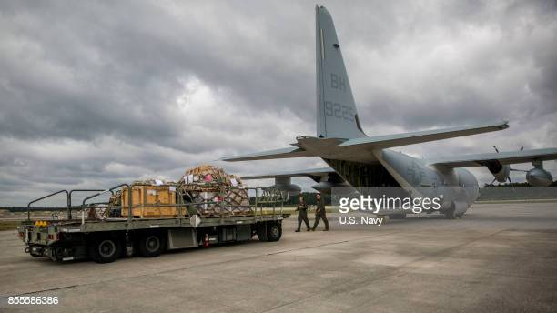 In this US Navy handout US Marines assigned to Marine Aerial Refueler Transport Squadron 252 load a KC130J Super Hercules at Marine Corps Air Station...
