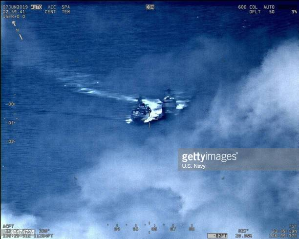 In this US Navy released handout a Russian Destroyer sails parallel in close proximity with the USS Chancellorsville at approximately 1145 am on June...