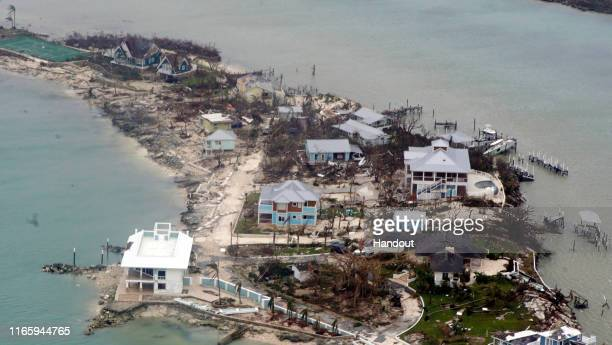 In this USCG handout image, an aerial view of houses in the Bahamas from a Coast Guard Elizabeth City C-130 aircraft after Hurricane Dorian shifts...