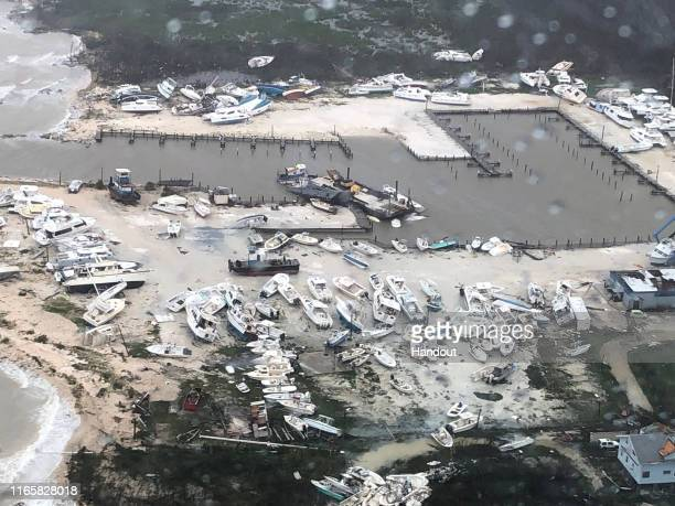 In this USCG handout image,damage is seen to a marina as Coast Guard Air Station Clearwater forward-deployed four MH-60 Jayhawk helicopter crews in...