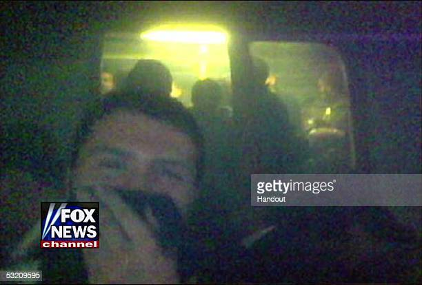 In this video grab from Fox News a victim is seen cover his mouth after a bomb blast July 7 2005 in London Four bombs exploded in three subway...