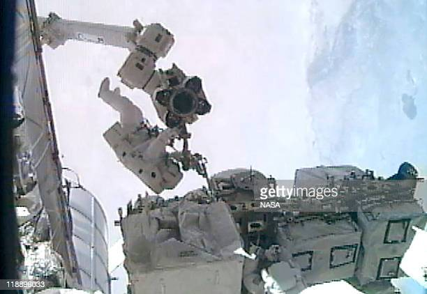 In this video screen grab provided by the National Aeronautics and Space Administration NASA astronaut Ronald Garan i installs a foot restraint on...