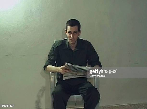 In this videograb made available by the Hamas on October 2 captured Israeli soldier Gilad Shalit is seen holding a Palestinian newspaper dated...