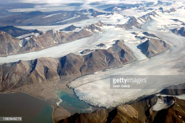 In this view from a passenger plane melting glaciers are seen during a summer heat wave on Svalbard archipelago on July 28 2020 near Longyearbyen...