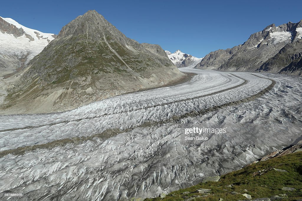 In this view from a trail descending from the Bettmerhorn peak the Aletsch glacier stretches down from its source in mountains above on August 24, 2016 near Bettmeralp, Switzerland. The Aletsch glacier, today approximately 23km long and up to 900 meters deep, is Switzerland's largest glacier and is shrinking rapidly. While glaciers across Europe have been receding since approximately the 1870s, the process has accelerated since the early 1980s, a phenomenon many scientists attribute to global warming. The European Enivironmental Agency predicts the volume of European glaciers will decline by between 22% and 89% by 2100, depending on the future intensity of greenhouse gases.