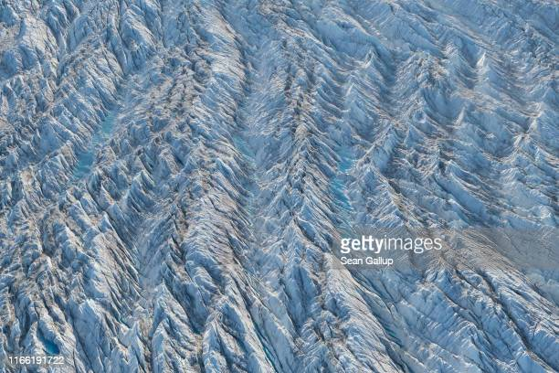 In this view from an airplane ice forms a ridged landscape on the Sermeq Kujalleq glacier also called the Jakobshavn glacier on August 04 2019 near...