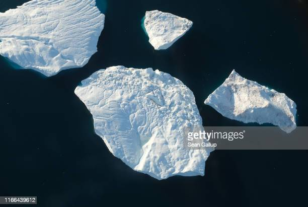 In this view from an airplane icebergs float at the mouth of the Ilulissat Icefjord on August 04 2019 near Ilulissat Greenland The Sahara heat wave...