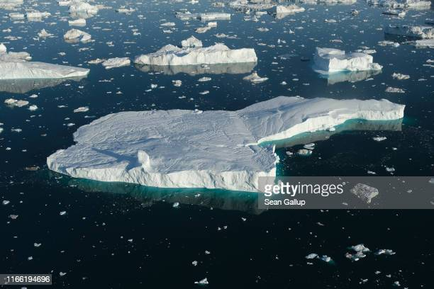 In this view from an airplane icebergs float in Disko Bay at sunset on August 04 2019 near Ilulissat Greenland The Sahara heat wave that recently...