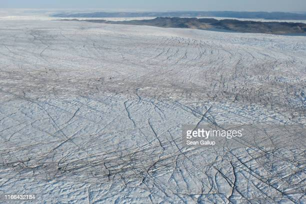 In this view from an airplane the Greenland ice sheet lies near the Sermeq Kujalleq glacier also called the Jakobshavn glacier on August 04 2019 near...
