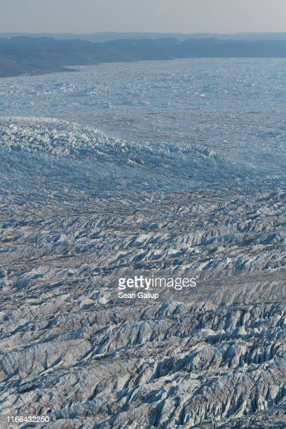 In this view from an airplane the Greenland ice sheet lies on August 04 2019 near Ilulissat Greenland The Sahara heat wave that recently sent...