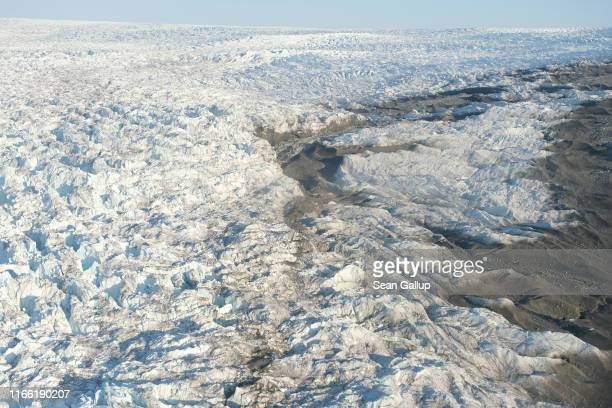 In this view from an airplane the Greenland ice sheet transitions into the Sermeq Avangnardleq glacier on August 04 2019 near Ilulissat Greenland The...