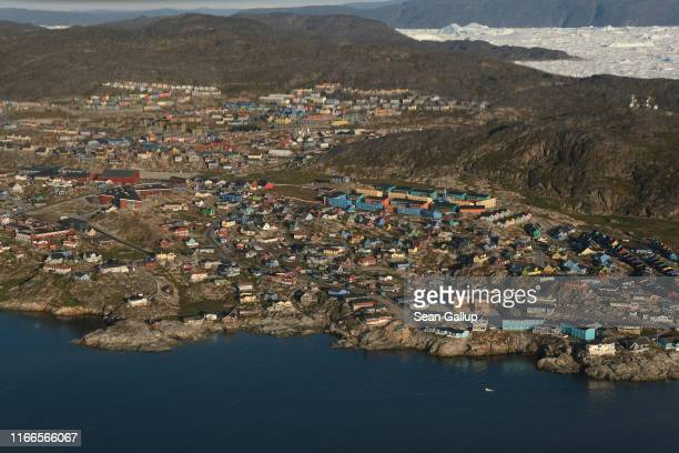 In this view from an airplane the town of Ilulissat is seen on Disko Bay on August 04, 2019 in Ilulissat, Greenland. As the Earth's climate warms...