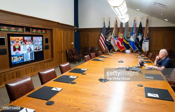 In this White House handout, U.S. President Joe Biden and Vice President Kamala Harris hold a video conference with the national security team to...