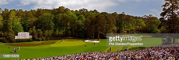 In three pictures combined as a digital composite American golfer and tournament winner Tiger Woods plays the Amen Corner at the US Masters Golf...