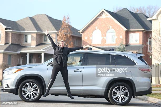 TORONTO ON DECEMBER 5 in Toronto on December 5 2015 Christina Ritchie poses with her Toyota Highlander