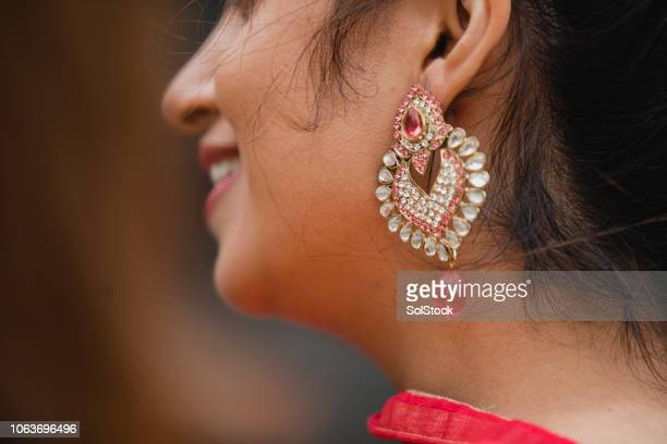 in traditional dress - earring stock pictures, royalty-free photos & images
