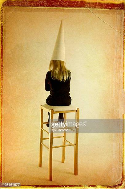 in trouble - dunce's hat stock pictures, royalty-free photos & images