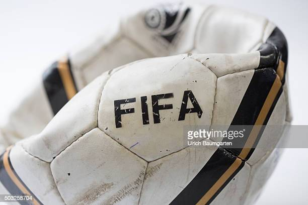 FIFA in turbulences Airless and destroyed football with the inscription FIFA