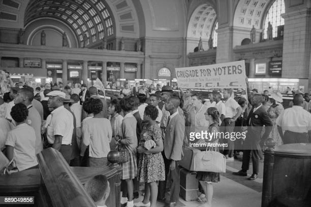 In Union Station demonstrators gather for the March on Washington for Jobs and Freedom Washington DC August 28 1963 A visible banner reads 'Crusade...
