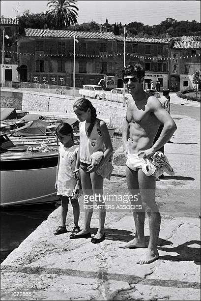 In VACANCY with FAMILY - Jean-Paul Belmondo and daughters Patricia and Florence in France on July 15, 1965