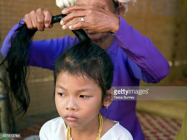In Van Lam village Ninh Thuan province Central Vietnam Cham girls usually in groups of around 5 undergo a Karoh ceremony one of the most important...