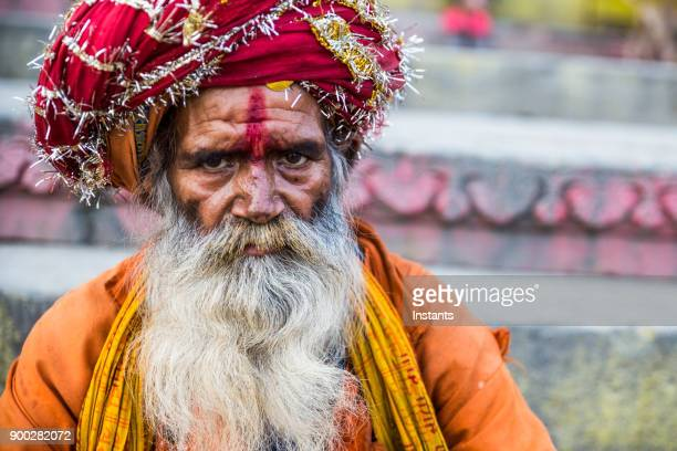 in varanasi, a serious indian sadhu looking at the camera. - religious role stock photos and pictures