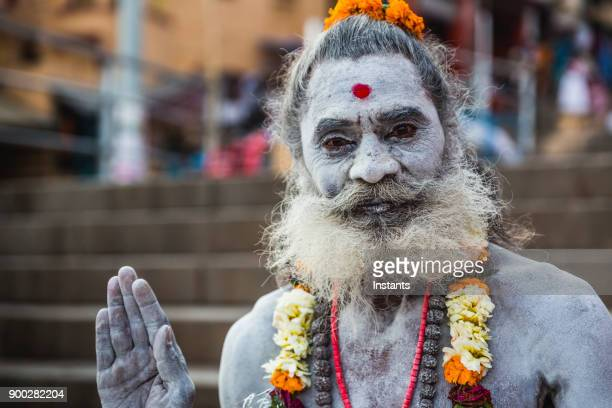 in varanasi, indian sadhu greeting people with his hand up. - human limb stock pictures, royalty-free photos & images