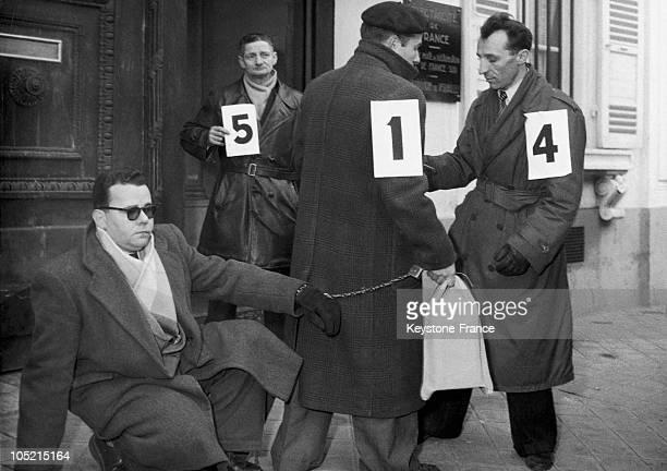 In Versailles On January 7 1952 Bricout An Accomplice Of Emile Buisson Linked To A Police Inspector By A Chain Helps To Reconstruct The Murder Of An...