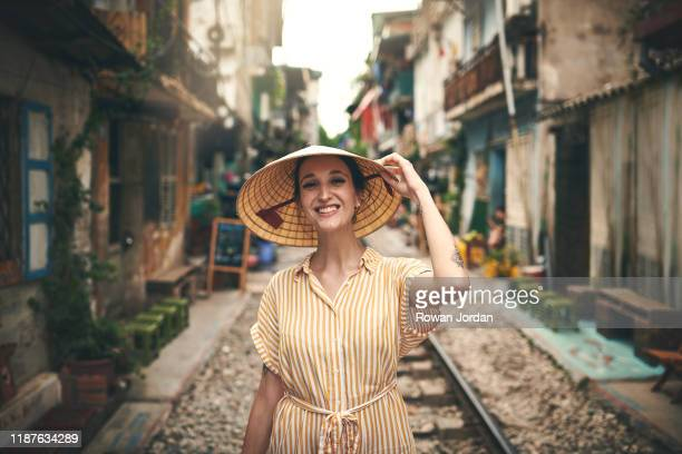 in vietnam this hat is call nón lá - pretty vietnamese women stock pictures, royalty-free photos & images