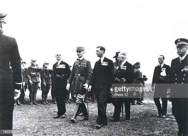 In VillersBretonneux King George VI inspecting the French Guard of Honour of the 51th infantry regiment